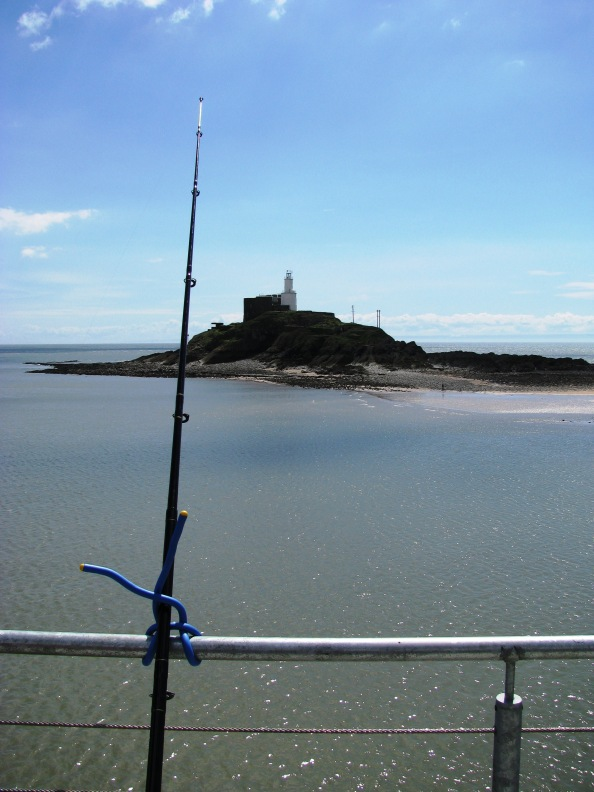 Fishing Off Mumbles Pier With Lighthouse